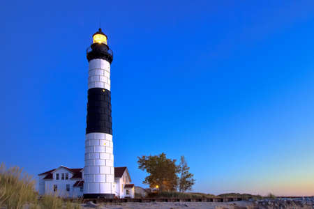 ludington: Light Up The Night. Historical Big Sable Point Lighthouse on the shores of Lake Michigan. Ludington State Park. Ludington, Michigan.