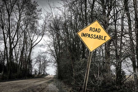 Desolate country road with Road Impassable sign. photo