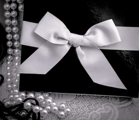 string of pearls: String of pearls and gift box in formal black tie elegance. Stock Photo