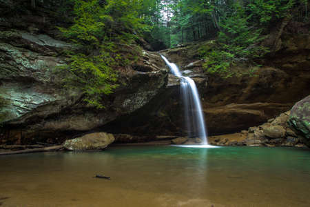 Waterfall In Paradise. Cascade along a hiking trail in Hocking Hills State Park. Logan, Ohio. photo