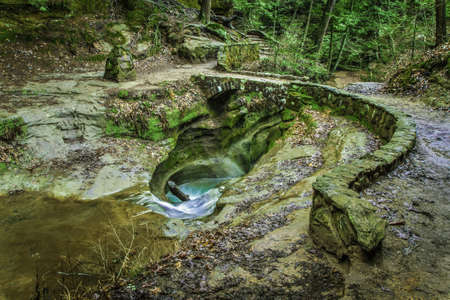 Unique geological formation dubbed The Devils Bathtub. Hocking Hills State Park. Logan, Ohio. photo