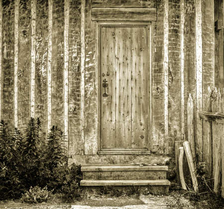 front stoop: Front door and stoop of historical European style cottage.