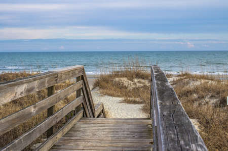 grand strand: Escape To The Beach. Worn wooden staircase leads to the Atlantic Ocean. Stock Photo