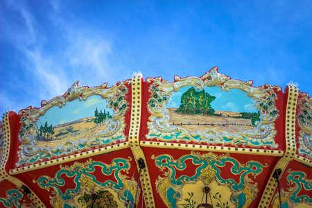 merry go round: Classic merry go round set against a blue sky background.