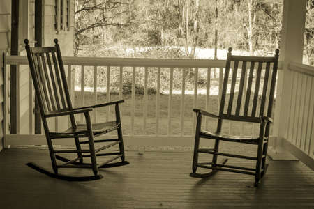 front view: Front Porch Sitting. Front porch with a pair of wooden rockers. Stock Photo