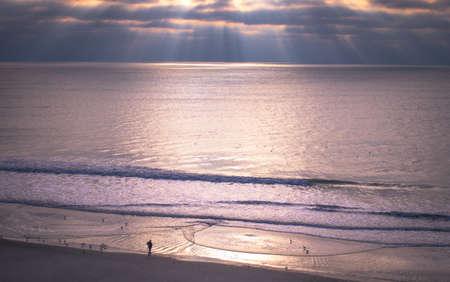 grand strand: Rays of light illuminate the Atlantic Ocean coast in Myrtle Beach, South Carolina.