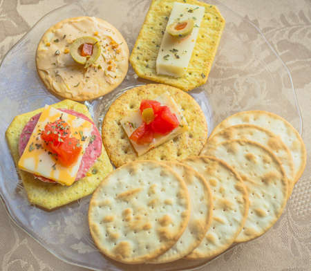 Elegant Appetizer. Water crackers with olives, cheeses, tomatoes and meats.