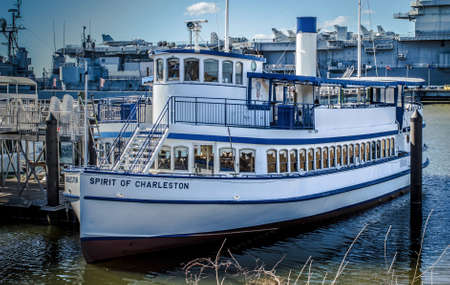 sc: Charleston, SC. March 1, 2015. The Spirit Of Charleston docked at Patriots Point with the USS Yorktown aircraft carrier in the background. Editorial