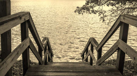 endings: Summers End. Nostalgic image of stairs leading to the lake as summer ends.