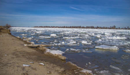 ice floes: Spring Thaw. Large ice floes make their way down the St. Clair River and the shipping season begins on one of the busiest waterways in the world. Algonac, Michigan.