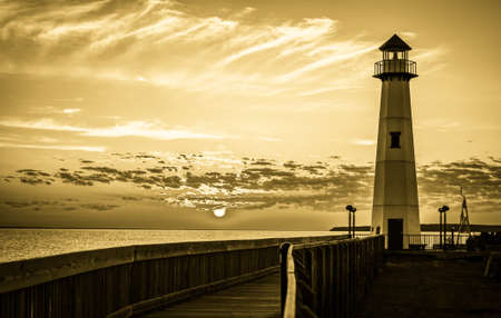dawns: New Day Dawns. The sunrise along the historic St. Igance boardwalk in Michigan Stock Photo