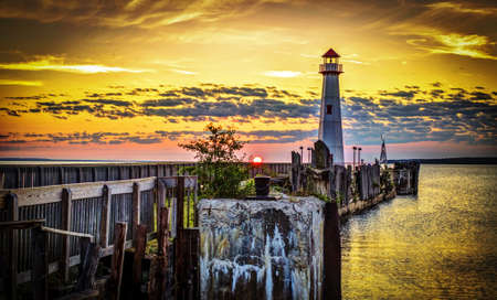 Lighthouse Sunrise. Sunrise along the historic waterfront of St. Ignace, Michigan as a new day begins.