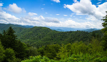 newfound gap: Newfound Gap Overlook. The Newfound Gap overlook straddles the North Carolina and Tennessee state line and is one of the most popular tourist stops in the Great Smoky Mountains National Park. Stock Photo