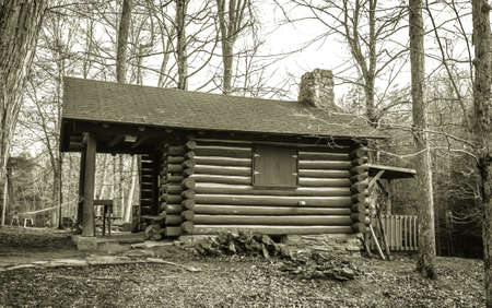 state owned: Log Cabin Classroom. This quaint log cabin the woods of Southeastern Ohio serves as the Naturalist Cabin classroom in Hocking Hills State Park in Logan, Ohio. Public structure located within a state park and is not a privately owned property. Stock Photo