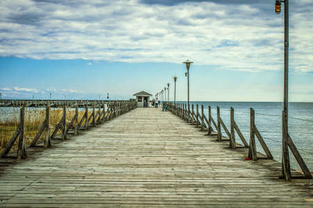 fishing pier: Coastal Fishing Pier Background. Stock Photo