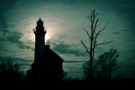 lakeshore: Spooky Lighthouse Silhouette. Au Sable Lighthouse silhouette in Picture Rocks National Lakeshore in Michigans Upper Peninsula.