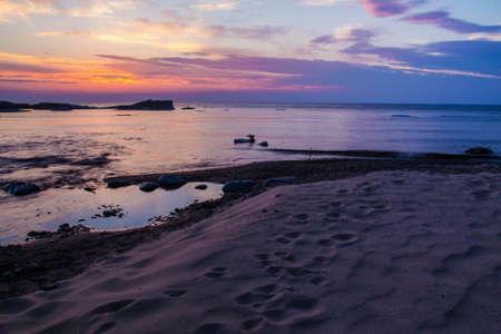 lakeshore: Sunset Beach Horizon. A beautiful Lake Superior sunset beach at the Hurricane River Campground in Pictured Rocks National Lakeshore.