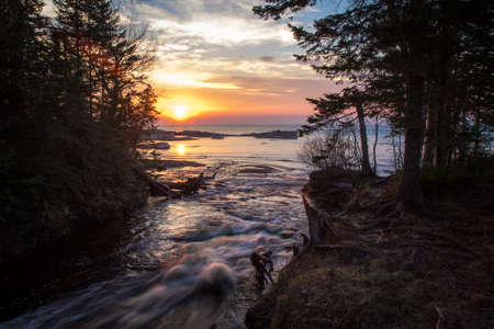 empties: Pictured Rocks National Lakeshore Sunset. The Hurricane River as it empties into Lake Superior at sunset.
