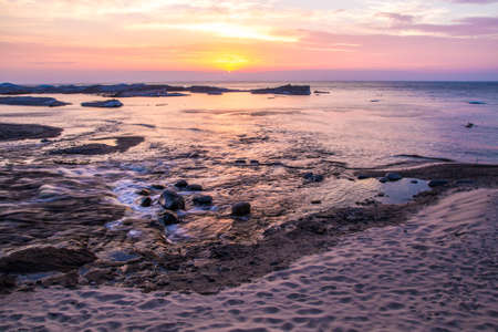 pictured: Wild Lake Superior coast at sunset in Pictured Rocks National Lakeshore in Munising, Michigan.