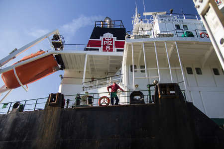 freighter: Sault Ste. Marie, Michigan, USA - May 31, 2014. Crew member waits as the ocean freighter Pilica makes it way through the American side of the Soo Locks. The Pilicas home port is Valletta, Malta. Editorial