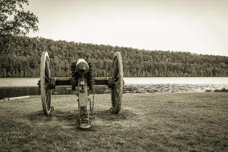 fanny: Antique Cannon. Antique cannon on the shore of Lake Fanny Hoe in Fort Wilkins State Historical Park in Copper Harbor, Michigan. Stock Photo