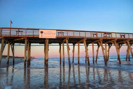 myrtle beach: Myrtle Beach, South Carolina, USA - February 25, 2014. Welcome sign on a Atlantic coastal pier on the South Carolina coast at sunset.