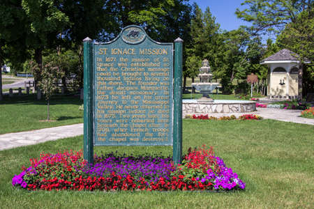 marquette: Mission Park. St. Ignace, Michigan, USA - July 5, 2015. St. Ignace Michigan was established by Father Jacques Marquette in 1671. It is the second oldest city in Michigan. Mission Park commemorates Father Marquette.