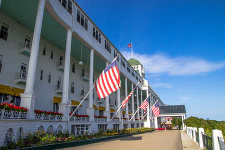 Grand Hotel. Mackinaw Island, Michigan. USA. July 6, 2015. The beautiful Grand Hotel located on Mackinaw Island opened in 1887. At 660 feet long the hotel boasts of having the largest front porch in the world. Editorial
