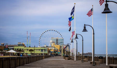grand strand: Downtown Myrtle Beach. Myrtle Beach, South Carolina, USA - February 9, 2015. Myrtle Beach boardwalk on the Atlantic coast in South Carolina.