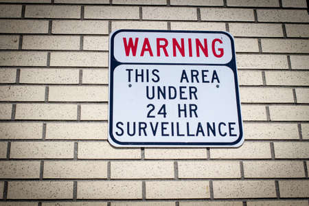 big brother: Big Brother Is Watching. Warning sign for would be intruders and those who desire privacy. Stock Photo