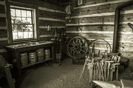 blacksmith shop: Copper Harbor, Michigan, USA - August 24, 2013. Interior of a blacksmith shop at Fort Wilkins State Historic Park in Copper Harbor, Michigan.