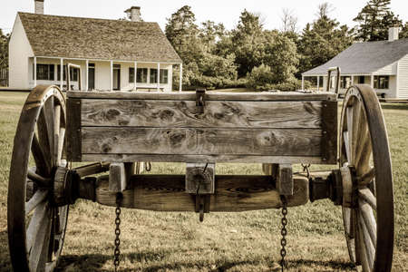 frontier: Vintage wooden wagon on display at Fort Wilkins State Historical Park. The park features a restored 1800s US Army fort on the northern frontier. Stock Photo