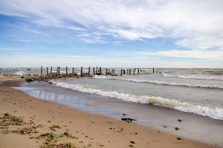 Haunted Lake Huron Beach. According to legend, a local girl named Minnie Quay fell in love with a sailor.  When he was lost at sea, she threw herself off this pier and drowned. Today, locals and tourists claim to see her ghost wandering this remote beach