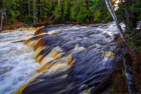 flowing river: The Tahquamenon River. The rushing waters of the Tahquamenon River from an overlook in the Lower Falls area. Paradise, Michigan.