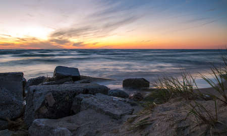 ludington: Lake Michigan Sunset. The sunset along the coast of Lake Michigan in Ludington State Park. Stock Photo