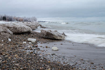 gale: The Gales Of November. The Great Lakes are synonymous with gale force winds and ship crushing waves in the month of November as the inland seas begin to turn to ice. Stock Photo