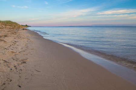 lake beach: Sunset Beach. Summer sunset on a deserted stretch of sandy beach on Lake Michigan.
