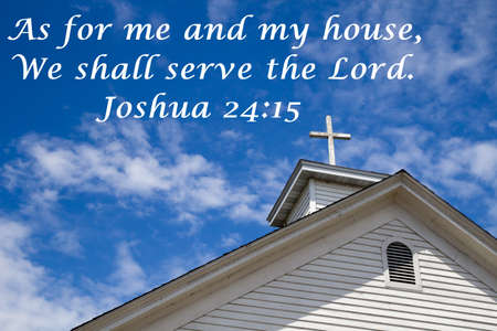 testament: As For Me And My House. Wooden cross with blue sky background and a popular scripture from the Old Testament. Stock Photo