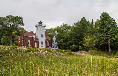 mile: Forty Mile Point Lighthouse. The Forty Mile Point Lighthouse was completed in 1896  and is on the Lake Huron coast. The light is owned by Presque Isle County and the grounds are open to visitors.