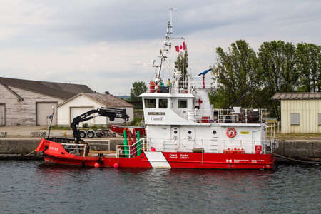 coast guard: Canadian Coast Guard. Sault Ste. Marie, Ontario, Canada - August 9, 2015. The Canadian Coast Guard Ship Cove Isle docked in Sault Ste. Marie. The ships home port is Parry Sound. Among its many duties, the ship maintains light stations and assists with sea