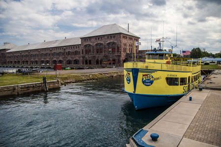 Soo Locks Boat Tour. Sault Ste. Marie, Michigan, USA - August 9, 2015. The Soo Locks Boat Tour takes visitors through the American and Canadian Soo Locks. The locks are one of the busiest shipping channels in the world.