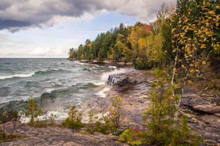 upper peninsula: Wild Lake Superior. Waves crash on the rugged and rocky shores of Lake Superior in Michigans Upper Peninsula.