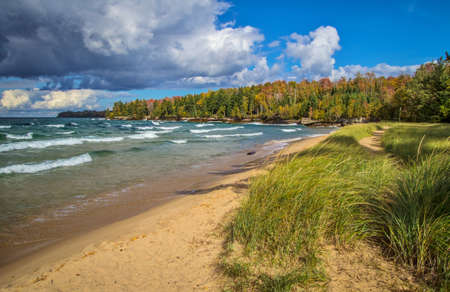upper peninsula: Autumn Day On The Lake Superior Coast. Waves, sun, surf and autumn colors on the shores of beautiful Lake Superior in Michigans Upper Peninsula. Stock Photo