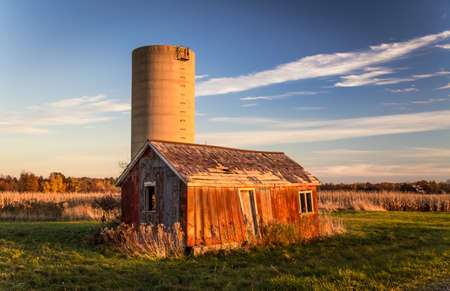 shack: Abandoned Shack And Silo. Abandoned shack and silo in Americas Midwest. Stock Photo