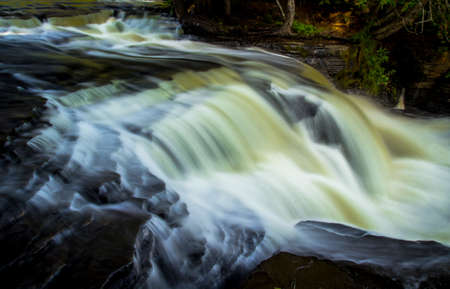 Lower Tahquamenon Falls. The Lower Tahquamenon Falls rushes through the wilderness of Michigans Upper Peninsula. Paradise, Michigan.