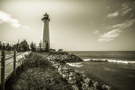 guiding light: Vintage Lake Superior Lighthouse. The Crisp Point Lighthouse on the shores of Lake Superior in black and white. The lighthouse was built in 1875 on the treacherous shores southern shore of the Great Lake.
