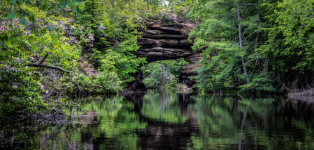 natural bridge state park: Tennessee Beauty. Kayaking the Natural Arch in Pickett State Park in Jamestown, Tennessee. This popular state park allows visitors to rent kayaks and view the the natural bridge up close. The park is exceptionally beautiful in June when the rhodendrons ar