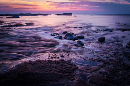 pictured: Springtime On The Shores Of Lake Superior. The sunsets on the shores of Lake Superior while icebergs float on the horizon. Pictured Rocks National Lakeshore. Munising, Michigan.