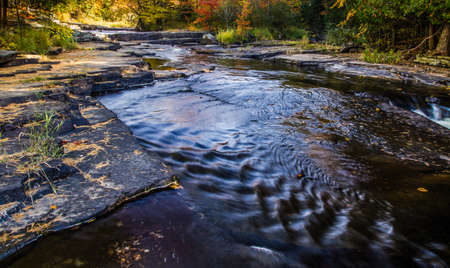 upper peninsula: Autumn River Reflections. The colors of autumn reflected in the waters of a wilderness river at Canyon Falls  in Michigans Upper Peninsula.