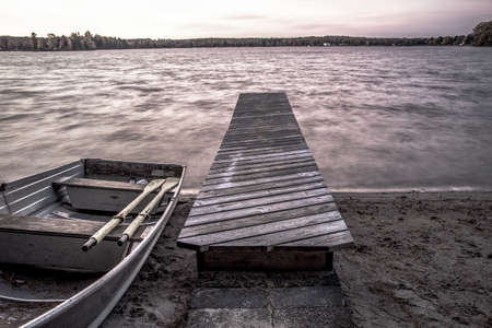 boat dock: Remote Wilderness Lake. Aluminum rowboat on the shores of a remote northern wilderness lake in Michigans Upper Peninsula.